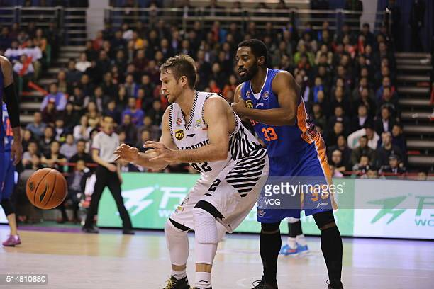 Shavlik Randolph of Liaoning Flying Leopards drives the ball against Mike Harris of Sichuan Blue Whales during the Chinese Basketball Association...