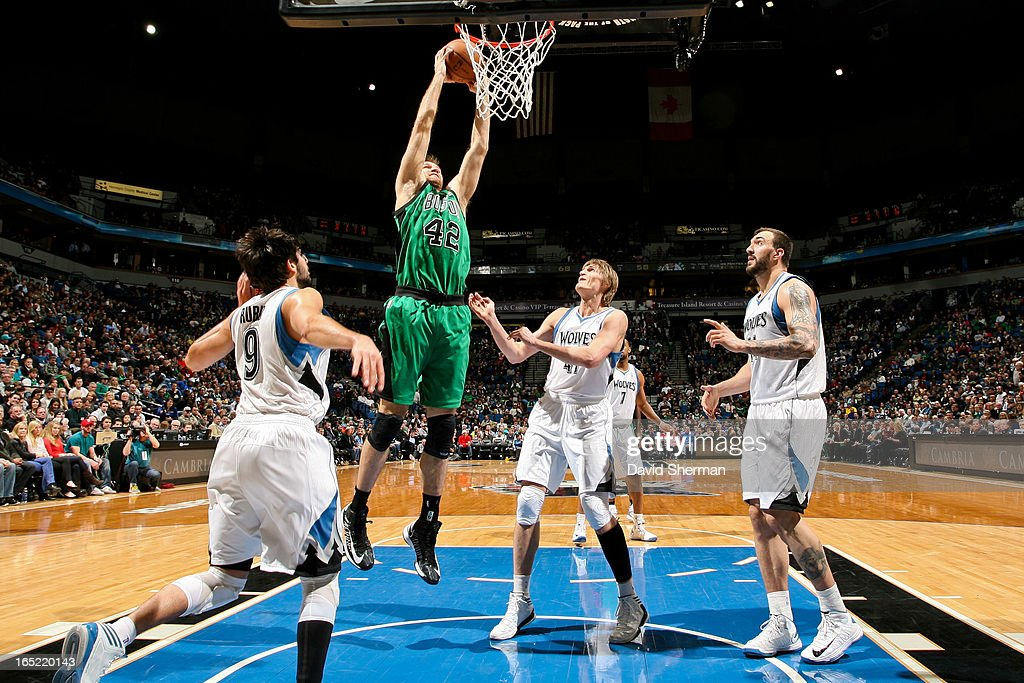 <a gi-track='captionPersonalityLinkClicked' href=/galleries/search?phrase=Shavlik+Randolph&family=editorial&specificpeople=210678 ng-click='$event.stopPropagation()'>Shavlik Randolph</a> #42 of the Boston Celtics rises for a dunk against <a gi-track='captionPersonalityLinkClicked' href=/galleries/search?phrase=Andrei+Kirilenko&family=editorial&specificpeople=201909 ng-click='$event.stopPropagation()'>Andrei Kirilenko</a> #47 of the Minnesota Timberwolves on April 1, 2013 at Target Center in Minneapolis, Minnesota.
