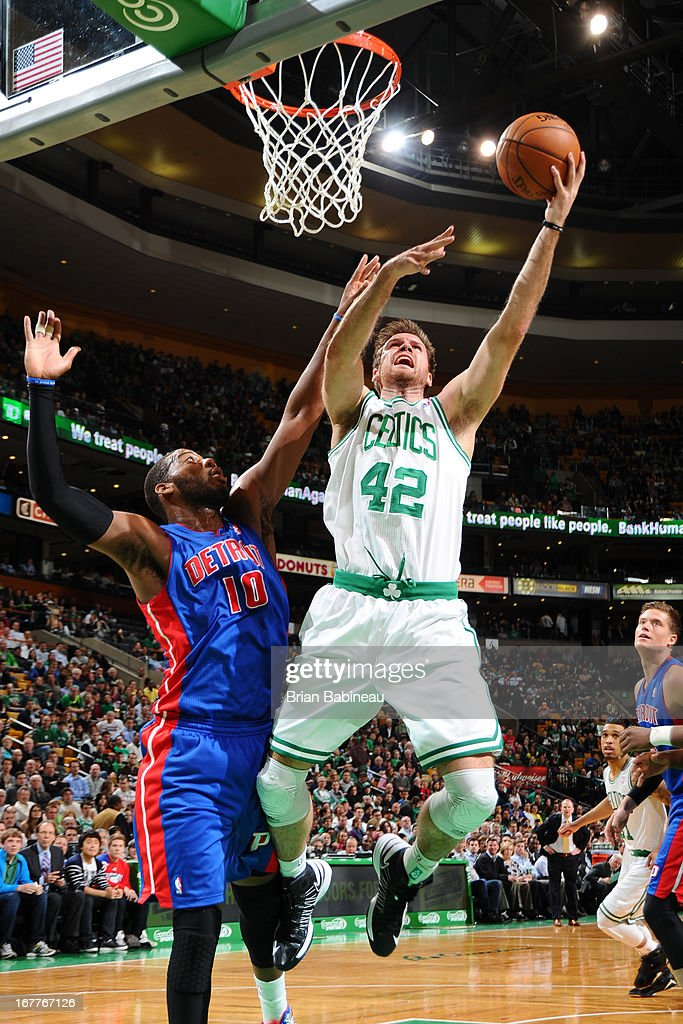 Shavlik Randolph #42 of the Boston Celtics shoots against Greg Monroe #10 of the Detroit Pistons on April 3, 2013 at the TD Garden in Boston, Massachusetts.