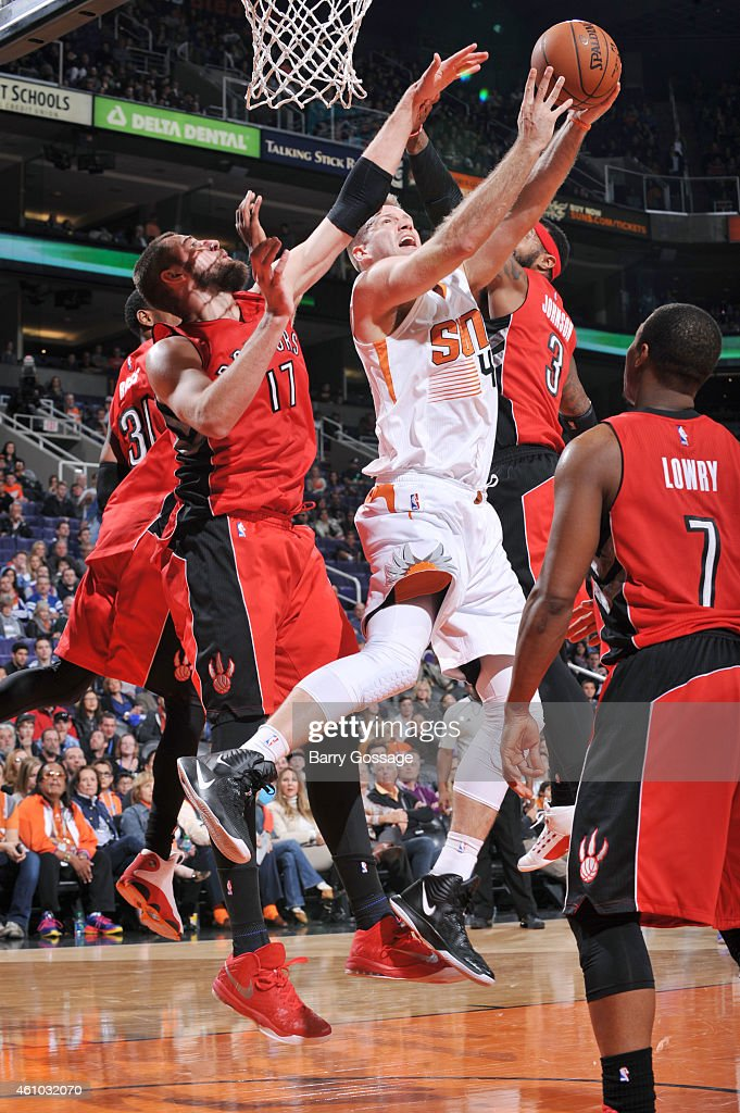 <a gi-track='captionPersonalityLinkClicked' href=/galleries/search?phrase=Shavlik+Randolph&family=editorial&specificpeople=210678 ng-click='$event.stopPropagation()'>Shavlik Randolph</a> #43 of the Phoenix Suns drives for a shot between <a gi-track='captionPersonalityLinkClicked' href=/galleries/search?phrase=Jonas+Valanciunas&family=editorial&specificpeople=5654195 ng-click='$event.stopPropagation()'>Jonas Valanciunas</a> #17 and <a gi-track='captionPersonalityLinkClicked' href=/galleries/search?phrase=James+Johnson+-+Basketballspieler&family=editorial&specificpeople=7670910 ng-click='$event.stopPropagation()'>James Johnson</a> #3 of the Toronto Raptors on January 4, 2015 at U.S. Airways Center in Phoenix, Arizona.