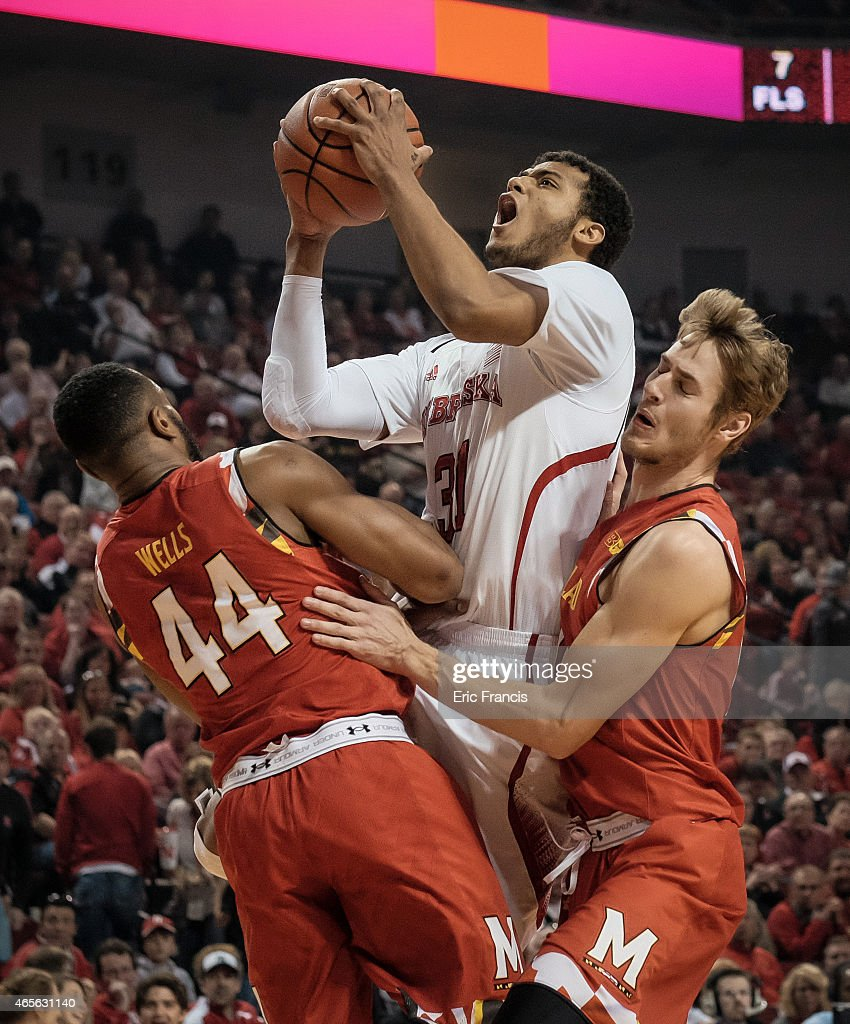 Shavon Shields #31 of the Nebraska Cornhuskers drives to the basket against Dez Wells #44 and Jake Layman #10 of the Maryland Terrapins during their game at Pinnacle Bank Arena March 8, 2015 in Lincoln, Nebraska.