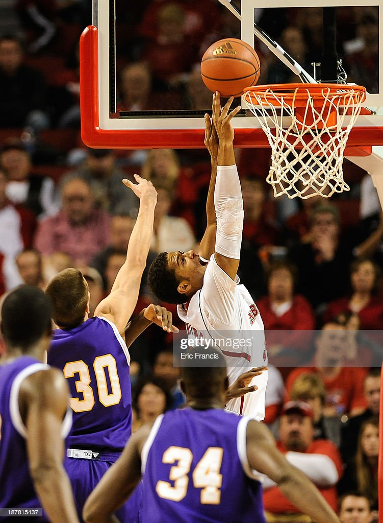 Shavon Shields #31 of the Nebraska Cornhuskers reaches for a rebound over Mike Miklusak #30 of the Western Illinois Leathernecks during their game at Pinnacle Bank Arena on November 12, 2013 in Lincoln, Nebraska.