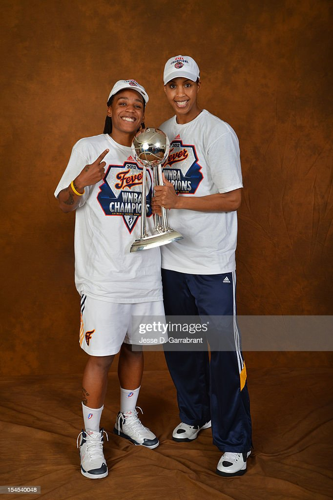 Shavonte Zellous #1 and Tammy Sutton-Brown #8 of the Indiana Fever poses for portraits with the Championship Trophy after Game four of the 2012 WNBA Finals on October 21, 2012 at Bankers Life Fieldhouse in Indianapolis, Indiana.