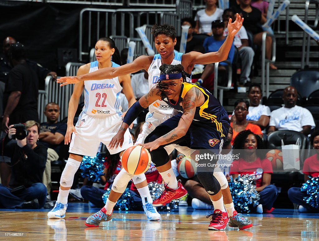 Shavonte Zellous #1 of the Indiana Fever battles for a loose ball against Angel McCoughtry #35 of the Atlanta Dream at Philips Arena on June 25, 2013 in Atlanta, Georgia.