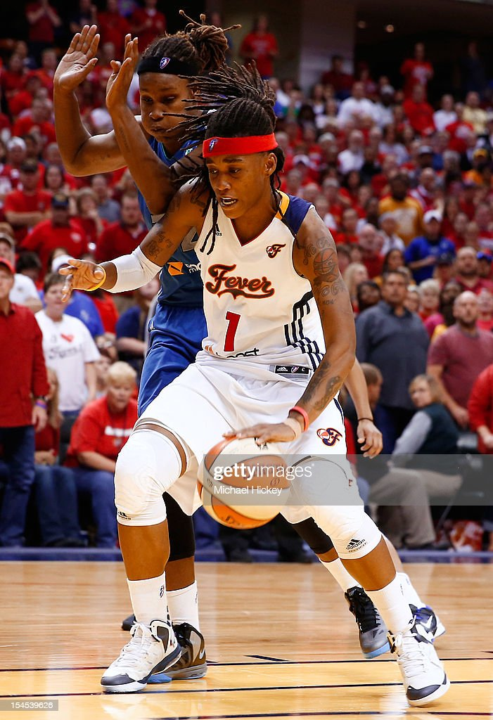 Shavonte Zellous #1 of the Indiana Fever dribbles ball against <a gi-track='captionPersonalityLinkClicked' href=/galleries/search?phrase=Rebekkah+Brunson&family=editorial&specificpeople=213521 ng-click='$event.stopPropagation()'>Rebekkah Brunson</a> #32 of the Minnesota Lynx during Game Four of the 2012 WNBA Finals on October 21, 2012 at Bankers Life Fieldhouse in Indianapolis, Indiana.