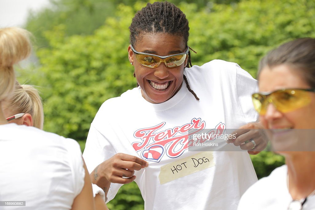 Shavonte Zellous of the Indiana Fever has some fun prior to the Fever taking part in a Habitat for Humanity build on May 17, 2013 in Indianapolis, Indiana.
