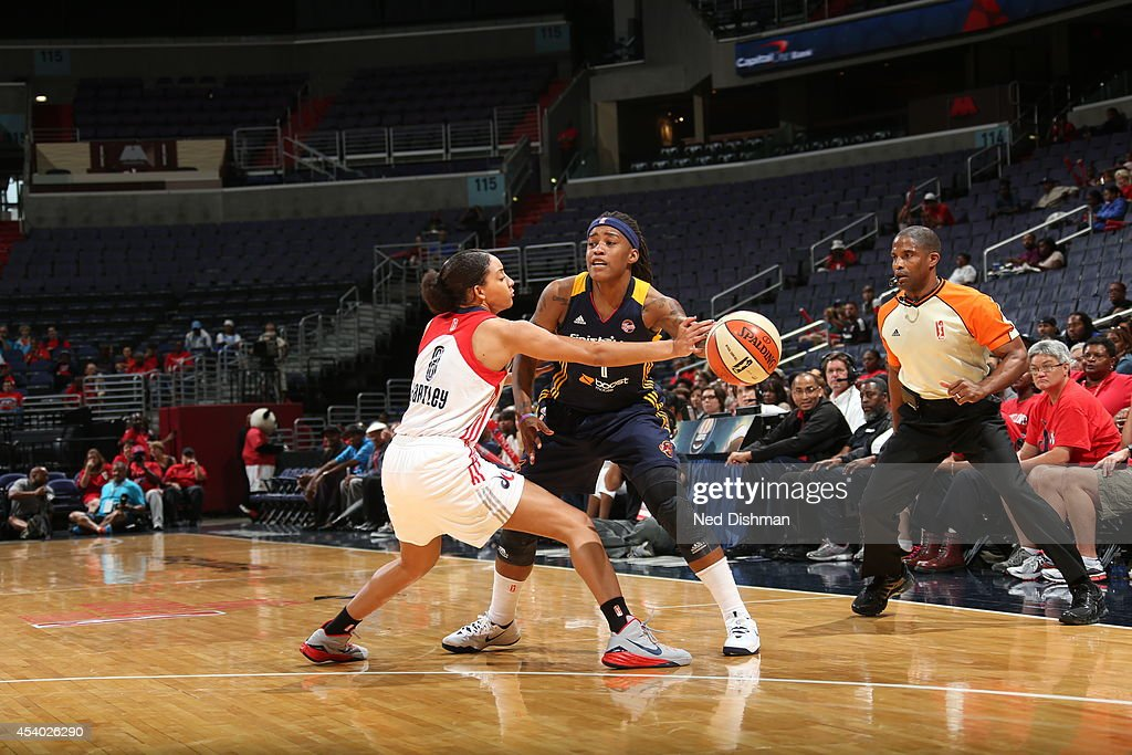 Shavonte Zellous #1 of the Indiana Fever passes the ball against Bria Hartley #8 of the Washington Mystics in Game Two of the Eastern Conference Semifinals during the 2014 WNBA Playoffs on August 23, 2014 at the Verizon Center in Washington, DC.