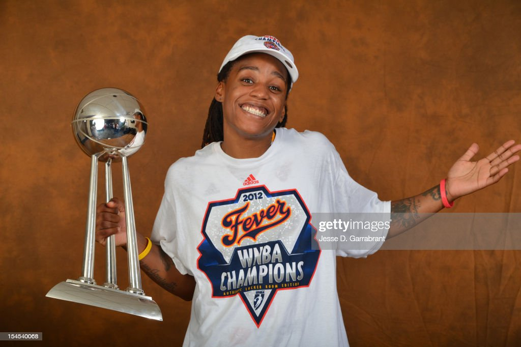 Shavonte Zellous #1 of the Indiana Fever poses for portraits with the Championship Trophy after Game four of the 2012 WNBA Finals on October 21, 2012 at Bankers Life Fieldhouse in Indianapolis, Indiana.