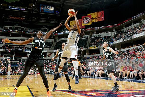 Shavonte Zellous of the Indiana Fever shoots against DeLisha Milton of the New York Liberty on May 31 2014 at Bankers Life Fieldhouse in Indianapolis...