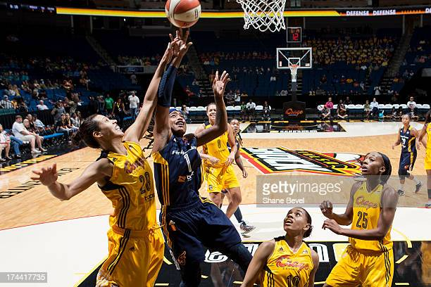 Shavonte Zellous of the Indiana Fever shoots against Nicole Powell of the Tulsa Shock during the WNBA game on July 25 2013 at the BOK Center in Tulsa...