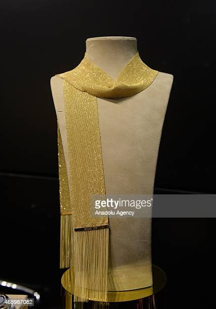 A shawl weaved with 22 carat gold by a special technique is displayed during the 40th Istanbul Jewelry Show on March 12 2015 at CNR Expo Fair Center...