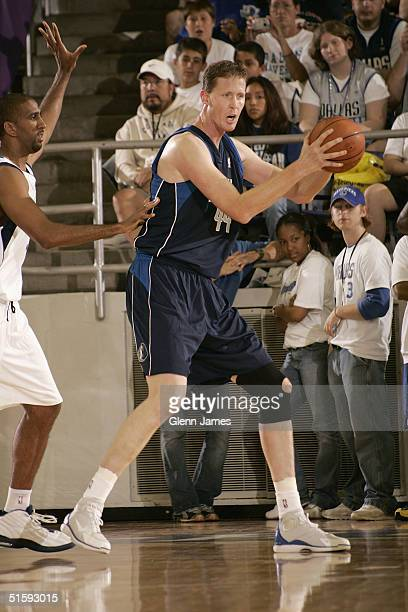 Shawn Bradley of the Dallas Mavericks posts up Calvin Booth during an intrasquad exhibition at the Mavs Fan Jam on October 9 2004 at Texas Christian...