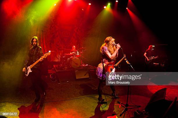 Shawn Dailey Stu Fisher Courtney Love and Micko Larkin of Hole perform on stage at Shepherds Bush Empire on February 17 2010 in London England