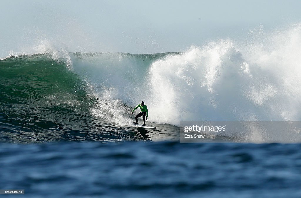 Shawn Dollar competes in the finals during the Mavericks Invitational surf competition on January 20, 2013 in Half Moon Bay, California.