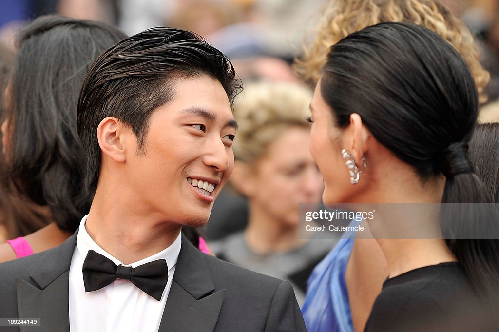 Shawn Dou and Ming Xi attend the 'Jeune & Jolie' premiere during The 66th Annual Cannes Film Festival at the Palais des Festivals on May 16, 2013 in Cannes, France.