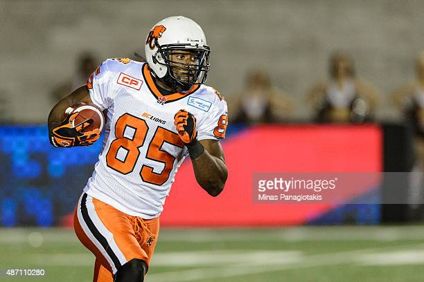 Shawn Gore of the BC Lions runs with the ball during the CFL game against the Montreal Alouettes at Percival Molson Stadium on September 3 2015 in...