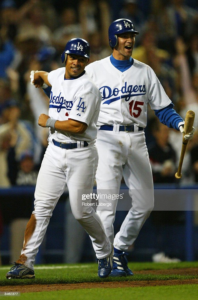 Shawn Green and Cesar Izturis celebrate after Cesar Izturis scored the winning run in the twelvth inning as the Los Angeles Dodgers beat the San...