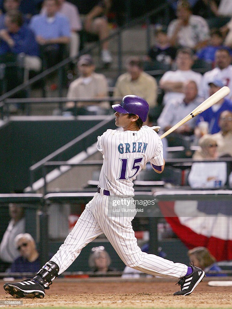 Shawn Green of the Arizona Diamondbacks hits a single in the seventh inning against the Chicago Cubs during the Diamondbacks home opener on April 4...