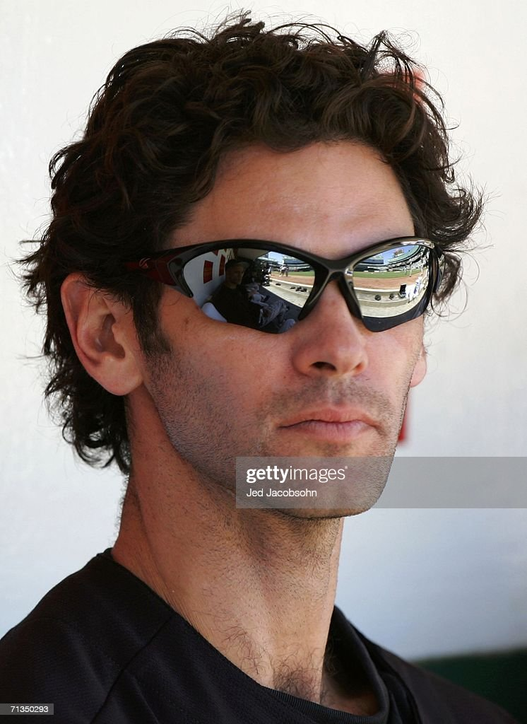 Shawn Green of the Arizona Diamondbacks looks on from the dugout during the game against the Oakland Athletics at McAfee Coliseum on July 1 2006 in...