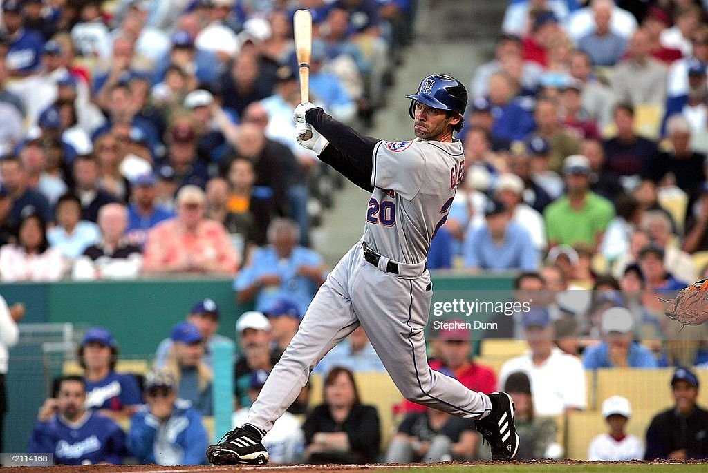 Shawn Green of the New York Mets hits a RBI double in the third inning during Game Three of the National League Division Series against the Los...