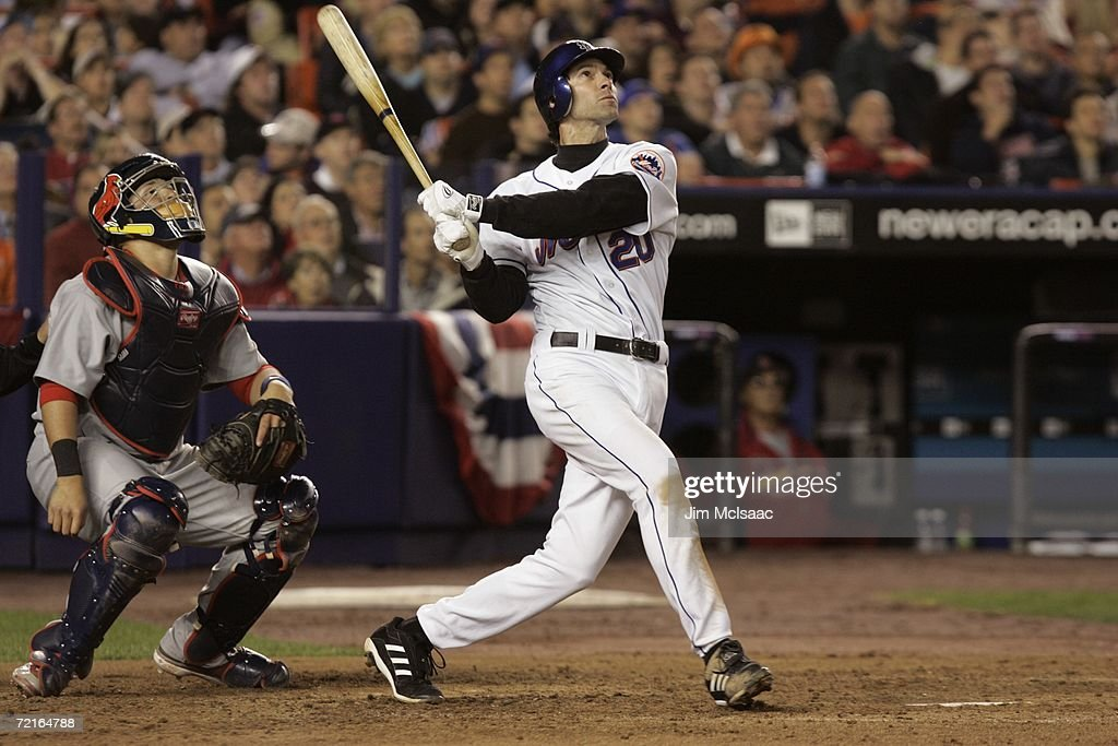Shawn Green of the New York Mets watches the flight of the ball as he follows through on his swing during game one of the NLCS against the St Louis...