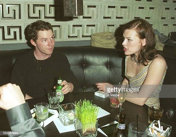 Shawn Hatosy and Milla Jovovich during Cartier Launches New Men's Watch '21 de Cartier' at 21 Club in Beverly Hills California United States