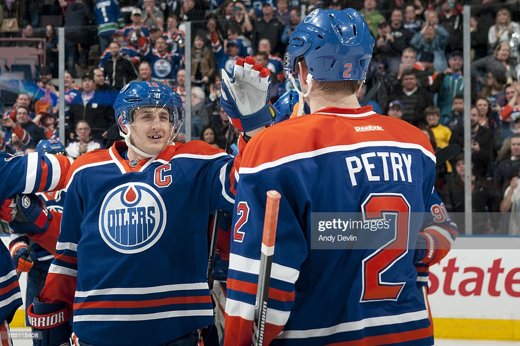<a gi-track='captionPersonalityLinkClicked' href=/galleries/search?phrase=Shawn+Horcoff&family=editorial&specificpeople=239536 ng-click='$event.stopPropagation()'>Shawn Horcoff</a> #10 and Jeff Petry #2 of the Edmonton Oilers celebrate after winning a game against the Vancouver Canucks on March 30, 2013 at Rexall Place in Edmonton, Alberta, Canada.