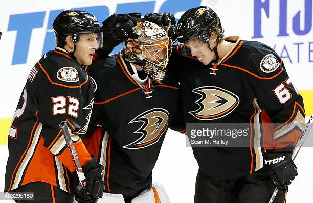 Shawn Horcoff and Rickard Rakell of the Anaheim Ducks congratulate goalie Anton Khudobin after defeating the Minnesota Wild 41 in a game at Honda...