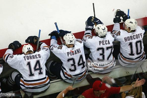 Shawn Horcoff Michael Peca Fernando Pisani and Raffi Torres react after being defeated by the Carolina Hurricane in game seven of the 2006 NHL...