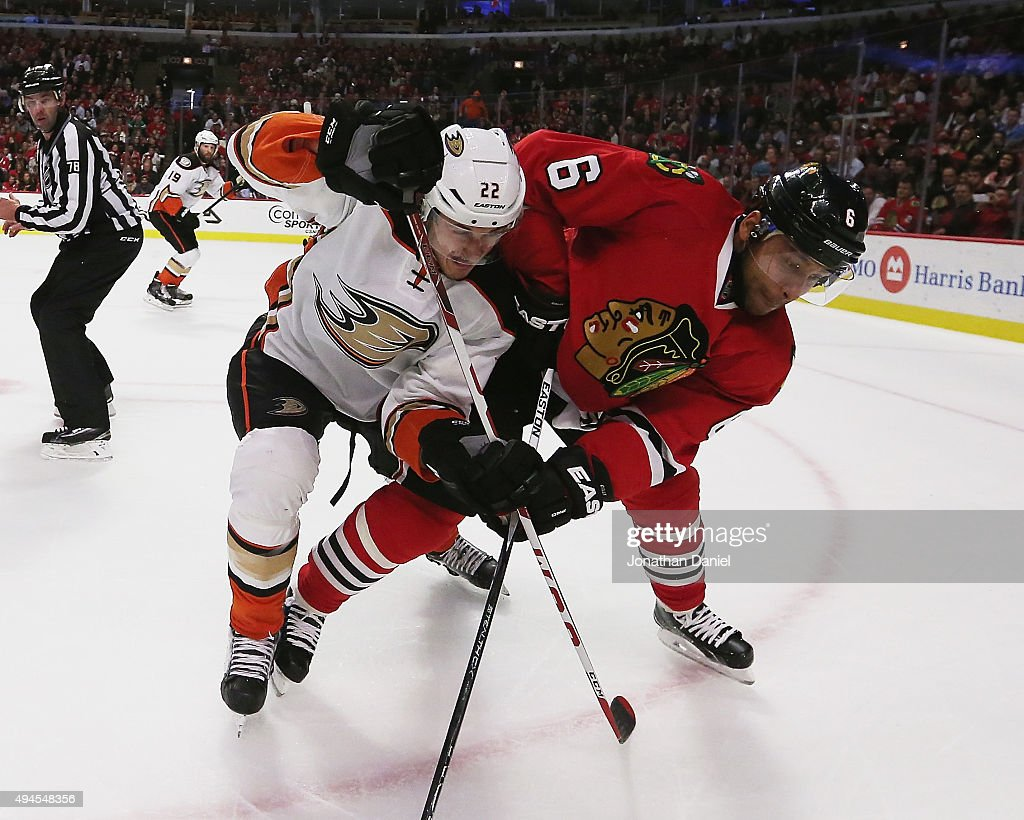 Shawn Horcoff of the Anaheim Ducks battles with Trevor Daley of the Chicago Blackhawks at the United Center on October 26 2015 in Chicago Illinois...
