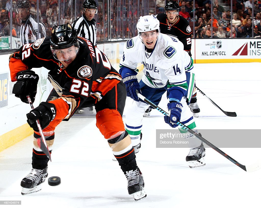 Shawn Horcoff of the Anaheim Ducks chases down the puck against Daniel Sedin of the Vancouver Canucks on October 12 2015 at Honda Center in Anaheim...