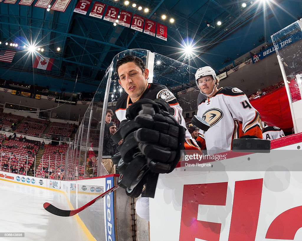 Shawn Horcoff of the Anaheim Ducks swipes the pucks off the dasher to the ice for warm ups before an NHL game against the Detroit Red Wings at Joe...