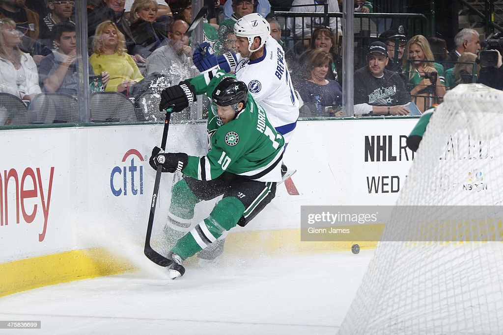 Shawn Horcoff of the Dallas Stars and Eric Brewer of the Tampa Bay Lightning collide along the end boards at the American Airlines Center on March 1...