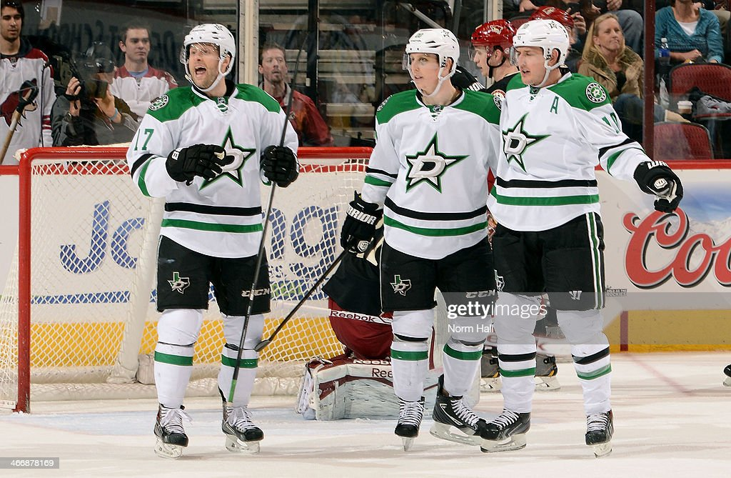 Shawn Horcoff #10 (R) of the Dallas Stars celebrates with teammates <a gi-track='captionPersonalityLinkClicked' href=/galleries/search?phrase=Rich+Peverley&family=editorial&specificpeople=554442 ng-click='$event.stopPropagation()'>Rich Peverley</a> #17 and <a gi-track='captionPersonalityLinkClicked' href=/galleries/search?phrase=Cody+Eakin&family=editorial&specificpeople=5662792 ng-click='$event.stopPropagation()'>Cody Eakin</a> #20 after his second period goal against the Phoenix Coyotes at Jobing.com Arena on February 4, 2014 in Glendale, Arizona.
