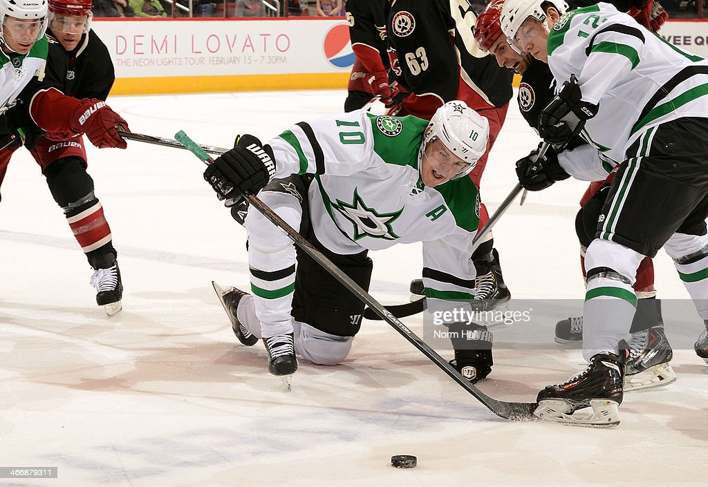 <a gi-track='captionPersonalityLinkClicked' href=/galleries/search?phrase=Shawn+Horcoff&family=editorial&specificpeople=239536 ng-click='$event.stopPropagation()'>Shawn Horcoff</a> #10 of the Dallas Stars falls to the ice as he battles for a loose puck with teammate <a gi-track='captionPersonalityLinkClicked' href=/galleries/search?phrase=Alex+Chiasson&family=editorial&specificpeople=5894597 ng-click='$event.stopPropagation()'>Alex Chiasson</a> #12 and <a gi-track='captionPersonalityLinkClicked' href=/galleries/search?phrase=Kyle+Chipchura&family=editorial&specificpeople=879784 ng-click='$event.stopPropagation()'>Kyle Chipchura</a> #24 of the Phoenix Coyotes during the first period at Jobing.com Arena on February 4, 2014 in Glendale, Arizona.