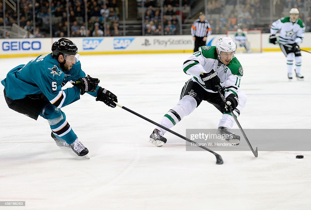 <a gi-track='captionPersonalityLinkClicked' href=/galleries/search?phrase=Shawn+Horcoff&family=editorial&specificpeople=239536 ng-click='$event.stopPropagation()'>Shawn Horcoff</a> #10 of the Dallas Stars gains control of the puck away from <a gi-track='captionPersonalityLinkClicked' href=/galleries/search?phrase=Jason+Demers&family=editorial&specificpeople=2282534 ng-click='$event.stopPropagation()'>Jason Demers</a> #5 of the San Jose Sharks during the first period at SAP Center on December 21, 2013 in San Jose, California.