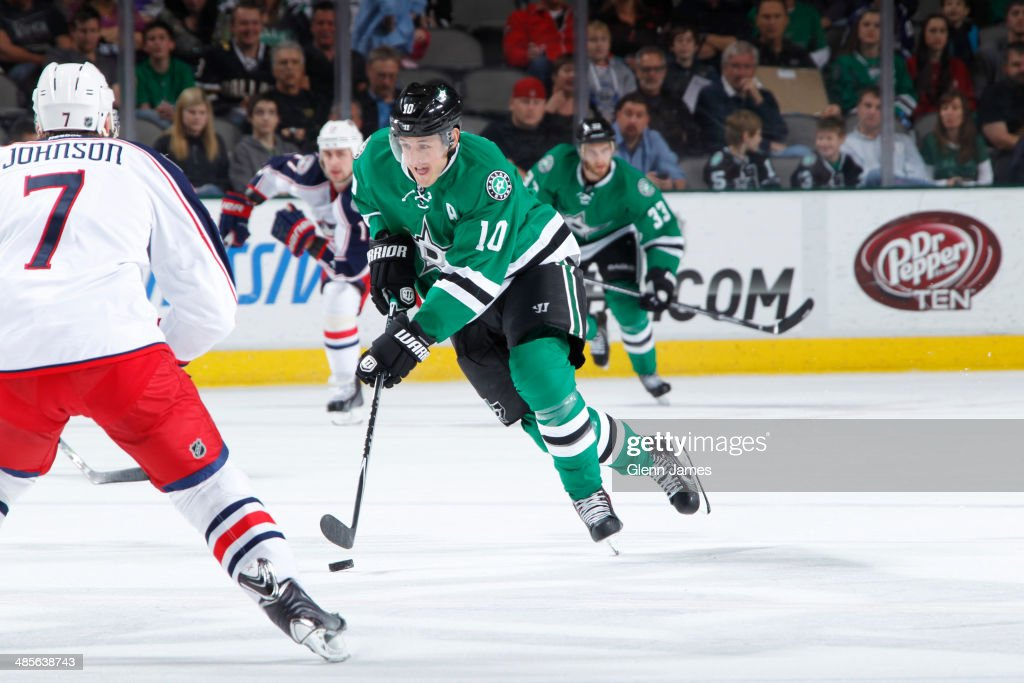 Shawn Horcoff of the Dallas Stars handles the puck against Jack Johnson of the Columbus Blue Jackets at the American Airlines Center on April 9 2014...