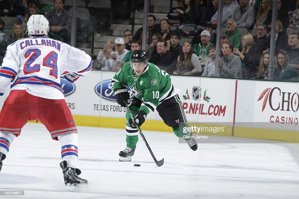 Shawn Horcoff of the Dallas Stars handles the puck against Ryan Callahan of the New York Rangers at the American Airlines Center on November 21 2013...