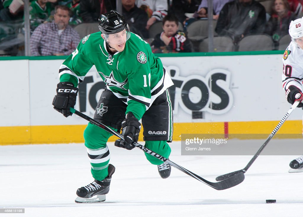 Shawn Horcoff of the Dallas Stars handles the puck against the Chicago Blackhawks at the American Airlines Center on March 21 2015 in Dallas Texas
