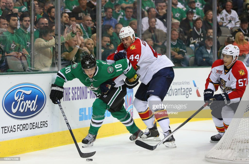 <a gi-track='captionPersonalityLinkClicked' href=/galleries/search?phrase=Shawn+Horcoff&family=editorial&specificpeople=239536 ng-click='$event.stopPropagation()'>Shawn Horcoff</a> #10 of the Dallas Stars skates the puck against <a gi-track='captionPersonalityLinkClicked' href=/galleries/search?phrase=Erik+Gudbranson&family=editorial&specificpeople=5741800 ng-click='$event.stopPropagation()'>Erik Gudbranson</a> #44 and <a gi-track='captionPersonalityLinkClicked' href=/galleries/search?phrase=Marcel+Goc&family=editorial&specificpeople=541626 ng-click='$event.stopPropagation()'>Marcel Goc</a> #57 of the Florida Panthers at American Airlines Center on October 3, 2013 in Dallas, Texas.