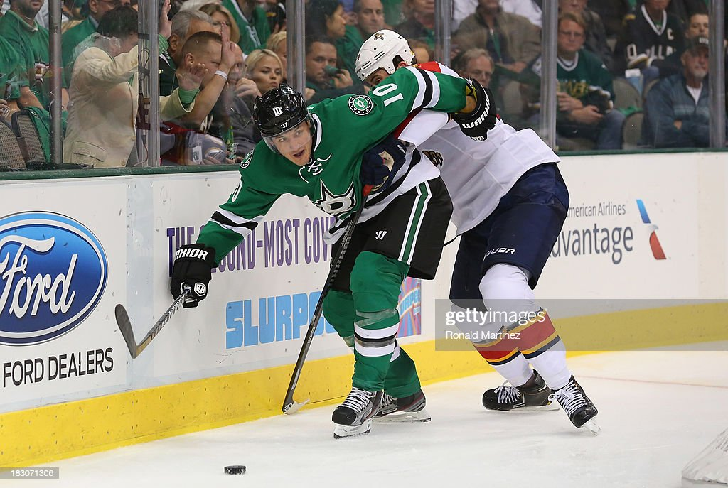 <a gi-track='captionPersonalityLinkClicked' href=/galleries/search?phrase=Shawn+Horcoff&family=editorial&specificpeople=239536 ng-click='$event.stopPropagation()'>Shawn Horcoff</a> #10 of the Dallas Stars skates the puck against <a gi-track='captionPersonalityLinkClicked' href=/galleries/search?phrase=Erik+Gudbranson&family=editorial&specificpeople=5741800 ng-click='$event.stopPropagation()'>Erik Gudbranson</a> #44 of the Florida Panthers at American Airlines Center on October 3, 2013 in Dallas, Texas.