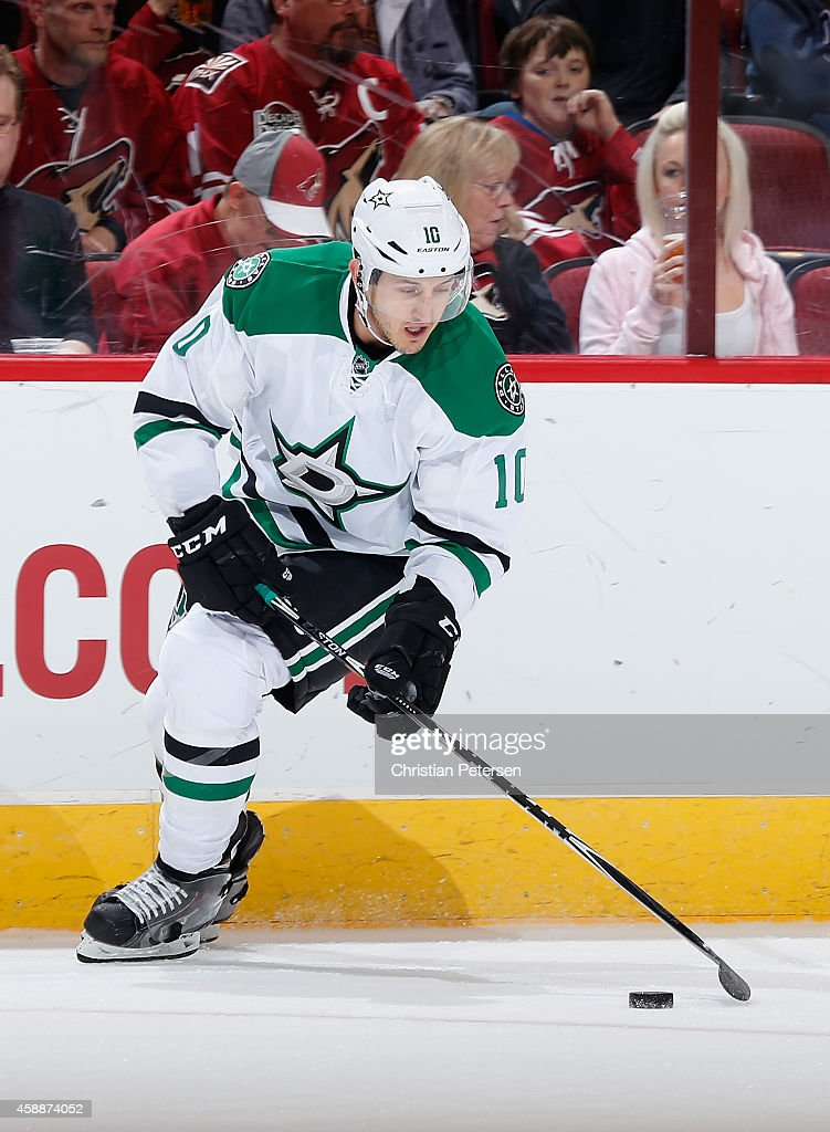 Shawn Horcoff of the Dallas Stars skates with the puck during the NHL game against the Arizona Coyotes at Gila River Arena on November 11 2014 in...