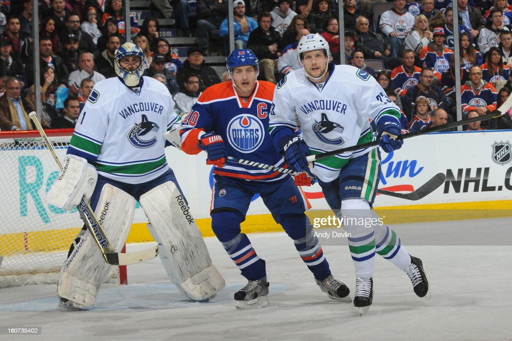 <a gi-track='captionPersonalityLinkClicked' href=/galleries/search?phrase=Shawn+Horcoff&family=editorial&specificpeople=239536 ng-click='$event.stopPropagation()'>Shawn Horcoff</a> #10 of the Edmonton Oilers battles for position against <a gi-track='captionPersonalityLinkClicked' href=/galleries/search?phrase=Alexander+Edler&family=editorial&specificpeople=882987 ng-click='$event.stopPropagation()'>Alexander Edler</a> #23 and <a gi-track='captionPersonalityLinkClicked' href=/galleries/search?phrase=Roberto+Luongo&family=editorial&specificpeople=202638 ng-click='$event.stopPropagation()'>Roberto Luongo</a> #1 of the Vancouver Canucks on February 4, 2013 at Rexall Place in Edmonton, Alberta, Canada.