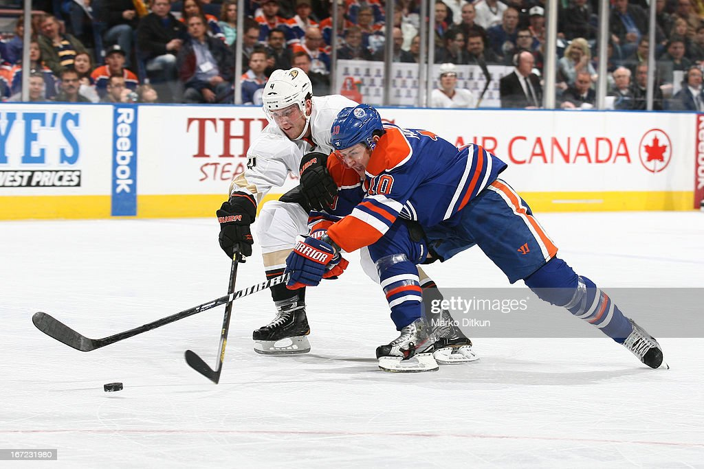 <a gi-track='captionPersonalityLinkClicked' href=/galleries/search?phrase=Shawn+Horcoff&family=editorial&specificpeople=239536 ng-click='$event.stopPropagation()'>Shawn Horcoff</a> #10 of the Edmonton Oilers battles for the puck against <a gi-track='captionPersonalityLinkClicked' href=/galleries/search?phrase=Cam+Fowler&family=editorial&specificpeople=5484080 ng-click='$event.stopPropagation()'>Cam Fowler</a> #4 of the Anaheim Ducks on April 22, 2013 at Rexall Place in Edmonton, Alberta, Canada.