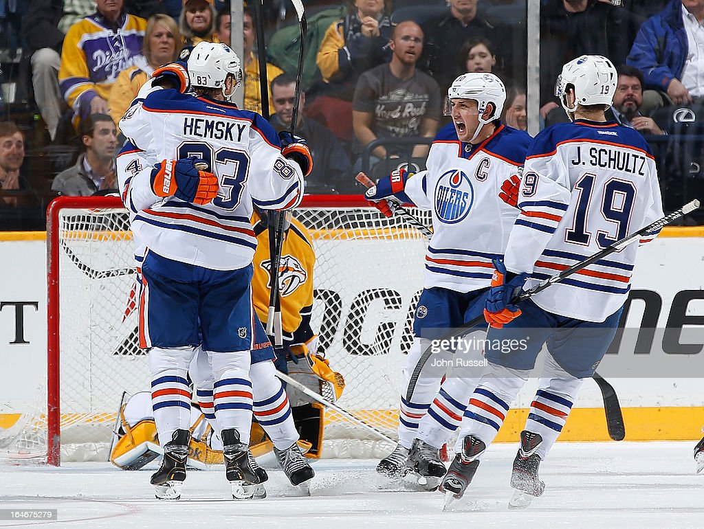 Shawn Horcoff #10 of the Edmonton Oilers celebrate a goal with Ales Hemsky #83 and Justin Schultz #19 against the Nashville Predators during an NHL game at the Bridgestone Arena on March 25, 2013 in Nashville, Tennessee.