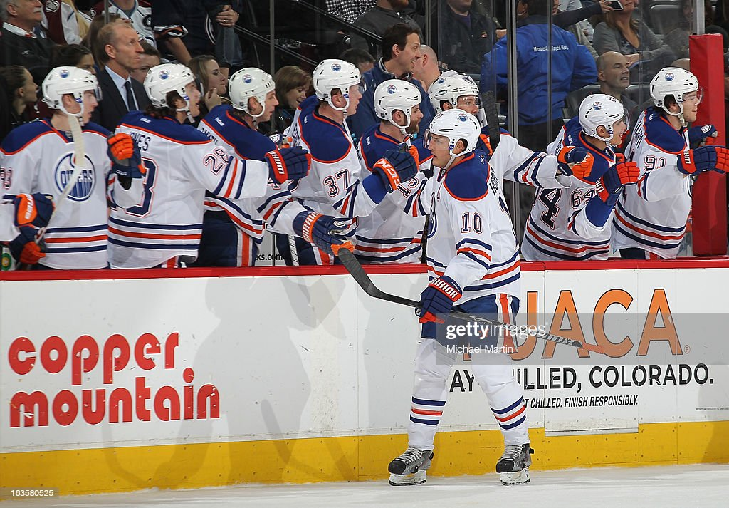 <a gi-track='captionPersonalityLinkClicked' href=/galleries/search?phrase=Shawn+Horcoff&family=editorial&specificpeople=239536 ng-click='$event.stopPropagation()'>Shawn Horcoff</a> #10 of the Edmonton Oilers celebrates a goal with teammates against the Colorado Avalanche at the Pepsi Center on March 12, 2013 in Denver, Colorado.