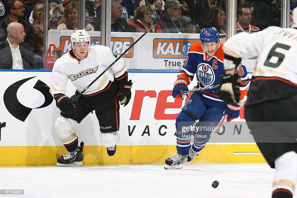 <a gi-track='captionPersonalityLinkClicked' href=/galleries/search?phrase=Shawn+Horcoff&family=editorial&specificpeople=239536 ng-click='$event.stopPropagation()'>Shawn Horcoff</a> #10 of the Edmonton Oilers skates for the puck against <a gi-track='captionPersonalityLinkClicked' href=/galleries/search?phrase=Cam+Fowler&family=editorial&specificpeople=5484080 ng-click='$event.stopPropagation()'>Cam Fowler</a> #4 of the Anaheim Ducks on April 21, 2013 at Rexall Place in Edmonton, Alberta, Canada.