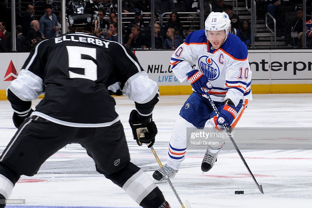 <a gi-track='captionPersonalityLinkClicked' href=/galleries/search?phrase=Shawn+Horcoff&family=editorial&specificpeople=239536 ng-click='$event.stopPropagation()'>Shawn Horcoff</a> #10 of the Edmonton Oilers skates with the puck against <a gi-track='captionPersonalityLinkClicked' href=/galleries/search?phrase=Keaton+Ellerby&family=editorial&specificpeople=4111546 ng-click='$event.stopPropagation()'>Keaton Ellerby</a> #5 of the Los Angeles Kings at Staples Center on April 6, 2013 in Los Angeles, California.