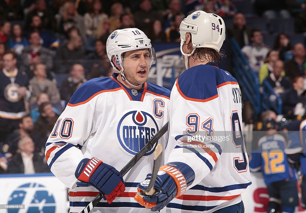 <a gi-track='captionPersonalityLinkClicked' href=/galleries/search?phrase=Shawn+Horcoff&family=editorial&specificpeople=239536 ng-click='$event.stopPropagation()'>Shawn Horcoff</a> #10 of the Edmonton Oilers talks with teammate <a gi-track='captionPersonalityLinkClicked' href=/galleries/search?phrase=Ryan+Smyth+-+Ice+Hockey+Player&family=editorial&specificpeople=202567 ng-click='$event.stopPropagation()'>Ryan Smyth</a> #94 in an NHL game against the St. Louis Blues on March 26, 2013 at Scottrade Center in St. Louis, Missouri.