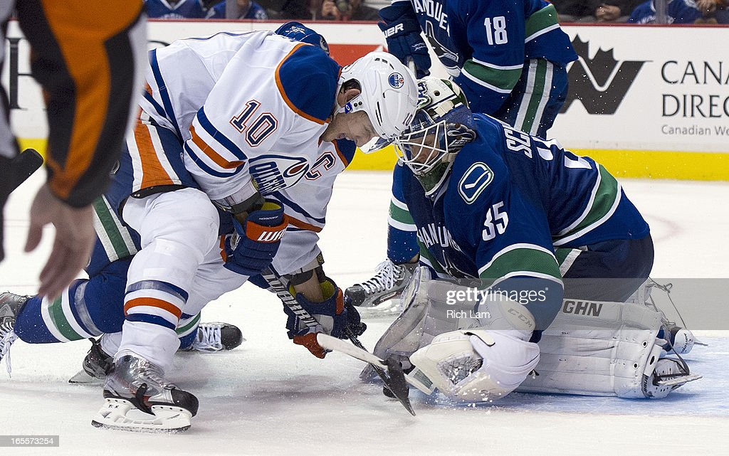<a gi-track='captionPersonalityLinkClicked' href=/galleries/search?phrase=Shawn+Horcoff&family=editorial&specificpeople=239536 ng-click='$event.stopPropagation()'>Shawn Horcoff</a> #10 of the Edmonton Oilers tries to jam the puck past goalie <a gi-track='captionPersonalityLinkClicked' href=/galleries/search?phrase=Cory+Schneider&family=editorial&specificpeople=696908 ng-click='$event.stopPropagation()'>Cory Schneider</a> #35 of the Vancouver Canucks during third period of NHL action on April 04, 2013 at Rogers Arena in Vancouver, British Columbia, Canada.